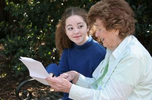 Image senior woman mentoring a teenage girl