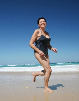 Image of a female retiree jogging on Delray Beach
