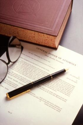 Lawbook, eyeglasses, and a Power of Attorney document