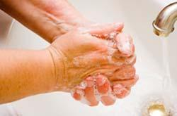 Nursing home worker washing her hands