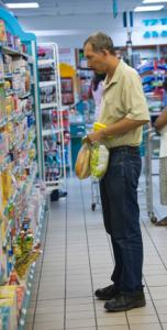 Senior man shopping at a grocery store