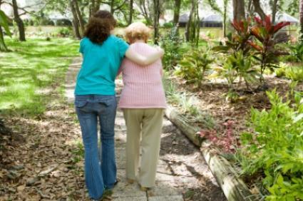 Woman_walking_with_grandmother.jpg