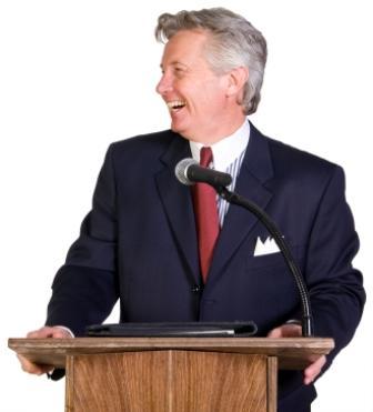 Man giving a retirement speech from a podium