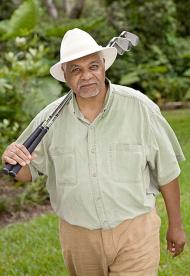 mature male model holding golf clubs