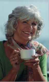 senior mature model holding coffee mug