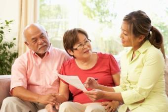 Seniors meeting with geriatric care consultant