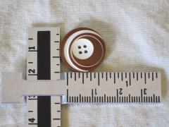 measuring button