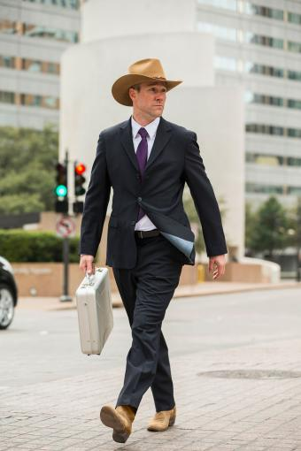 Man in suit and cowboy boots