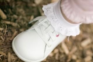 Closeup of baby's white walking shoe