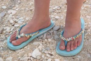 Pair of blue decorated flip flops