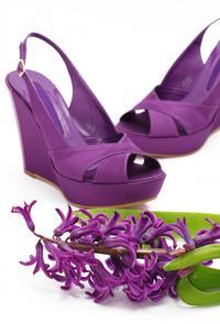 Pair of purple platform shoes with lilacs
