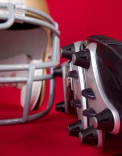 American football cleats and helmet
