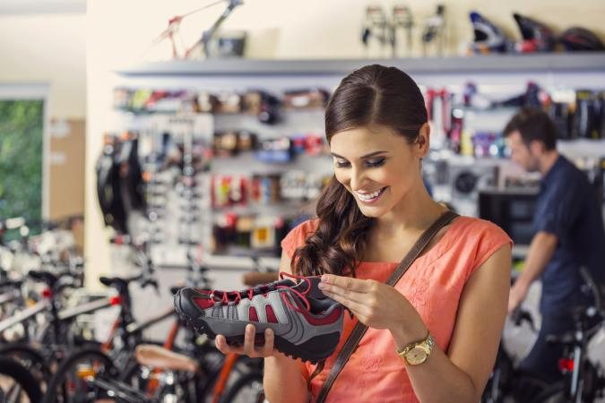 woman shopping for biking shoes