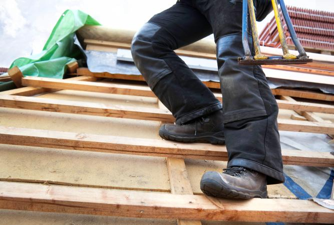 wearing safety shoes at construction site