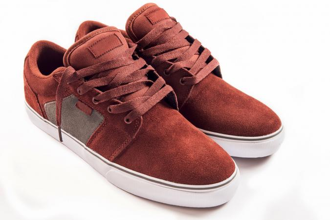 Pair of burgundy red skater sneakers