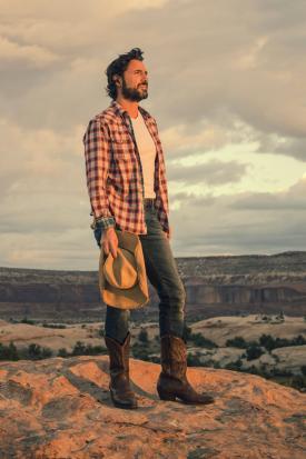 Man wearing cowboy boots