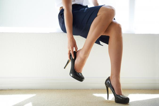 businesswoman putting on a pair of heels