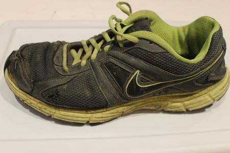 running shoes with tear on side