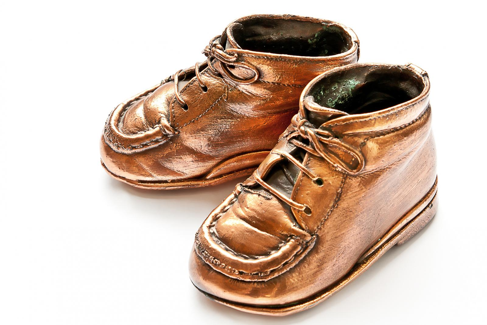 A pair of bronzed baby shoes