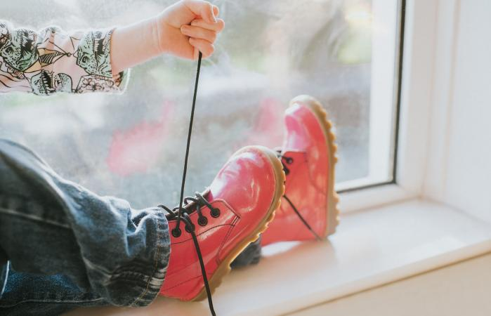 Child tying laces