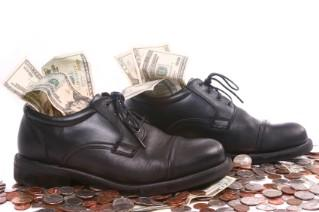 Men's shoes stuffed with money