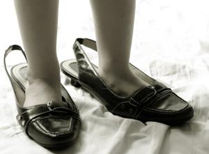 Feet in shoes many sizes too large