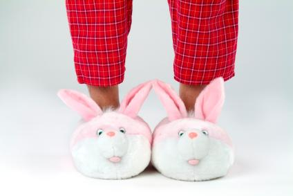 Person wearing plush bunny slippers