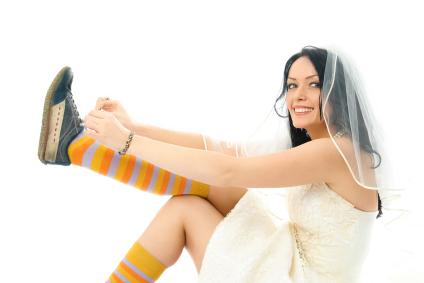 bride putting on sneakers