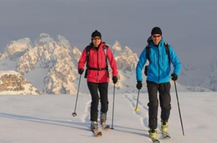 two backcountry skiers