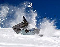 Snowboarder have a bad wipeout