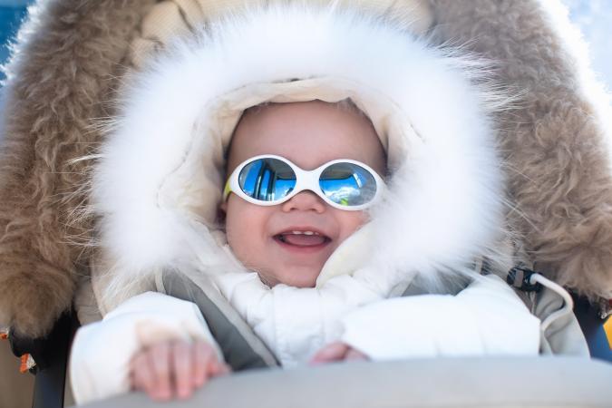 Baby in warm stroller