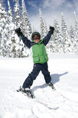 Image of an excited young skier