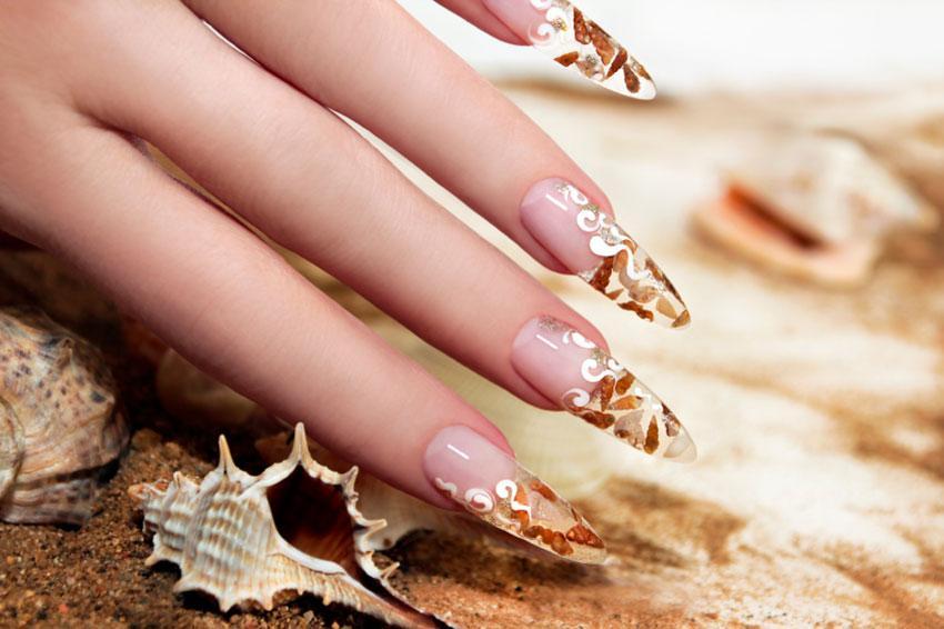 https://cf.ltkcdn.net/skincare/images/slide/177125-850x566-seashell-inspired-nail-art.jpg