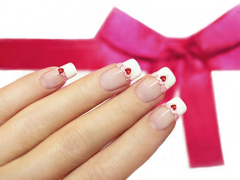 Valentines nail art ideas lovetoknow embellished french manicure solutioingenieria Choice Image