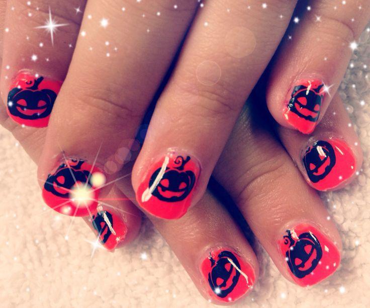 https://cf.ltkcdn.net/skincare/images/slide/187227-736x612-pumpkin-nail-art.jpg