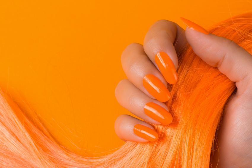 https://cf.ltkcdn.net/skincare/images/slide/228110-850x567-Orange-Nails.jpg