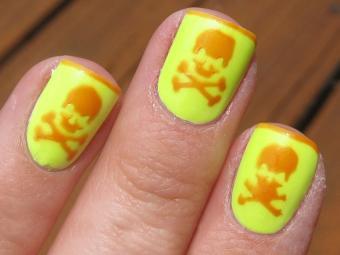 https://cf.ltkcdn.net/skincare/images/slide/178049-850x638-Polish-Art-Addict-Yellow-Orange-Skull-Nail-Art.jpg
