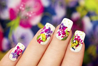 Bright floral nail art with small gold pearls