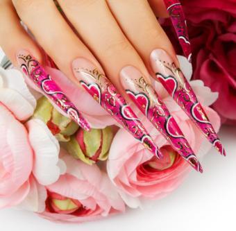 https://cf.ltkcdn.net/skincare/images/slide/184159-850x832-hearts-and-swirls-nail-art.jpg