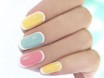 https://cf.ltkcdn.net/skincare/images/slide/184310-800x600-pastel-with-white-nail-art.jpg