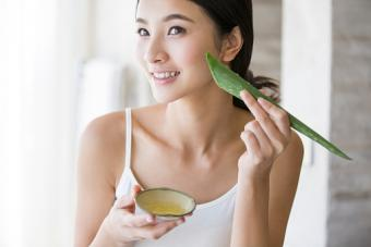 Young woman with aloe vera