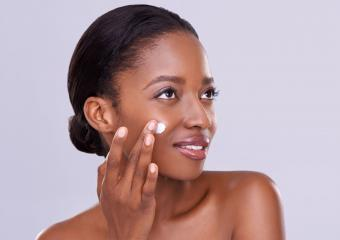 Woman using cocoa butter