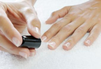 Applying clear polish to harden Nails