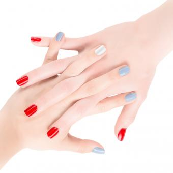 hands with red and blue gel nail polish