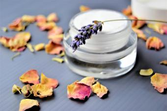 Moisturizer on a table decorated with rose petals