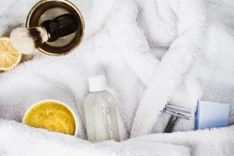 White bathrobe, shaving accessories, and homemade aftershave