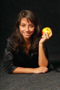 Photo of a young woman eating an apple