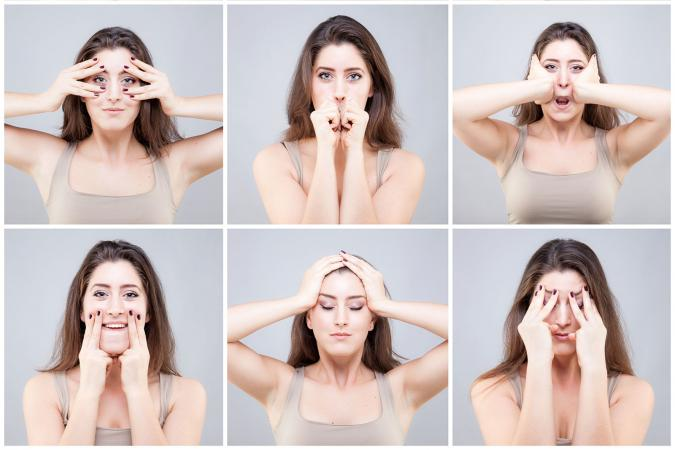 Woman doing face exercises