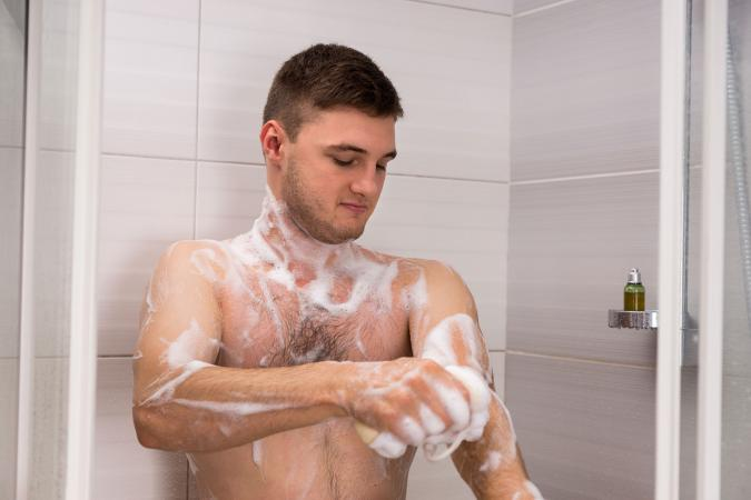 Man in shower bathing