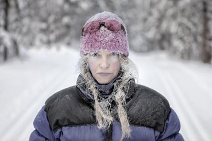 Blue-lipped woman outside in winter